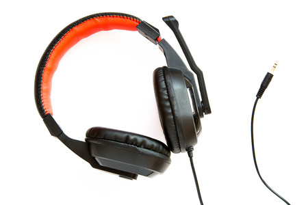 Pair of headphones on white background ready to be plugged in. Stock Photo