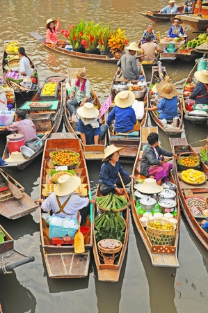 sunday market: Amphawa, Thailand , Jan 21, 2010 - Boats loaded with fruits and vegetables  in Amphawa Floating Market , Amphawa , Thailand.