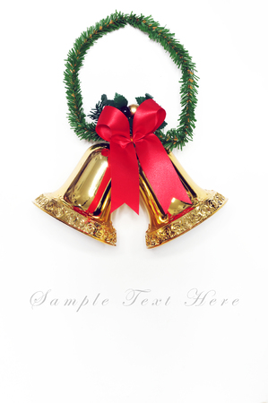 Golden bells with a red bow for background  photo