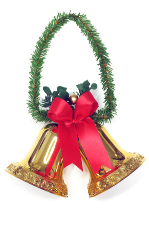 Golden bells with a red bow  photo