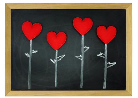 fabric hearts on blackboard  photo