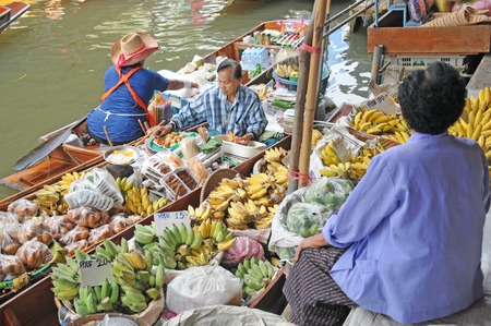 RATCHABURI, THAILAND,MARCH 21, 2013 - Boats loaded with  fruits and vegetables in Damnoen Saduak Floating Market  ,RATCHABURI, THAILAND