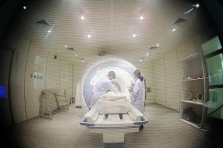 ct: veterinarian doctor working in MRI scanner room Stock Photo