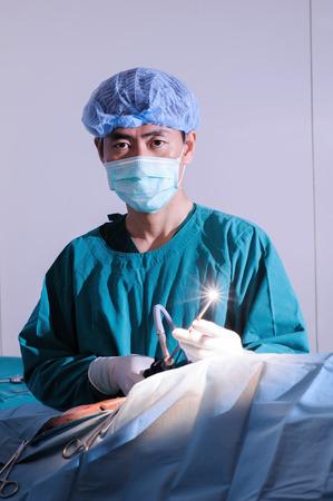 laparoscopic: veterinarian doctor in operation room for laparoscopic surgical (art lighting shot) Stock Photo