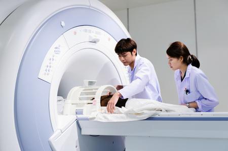 veterinarian doctor working in MRI scanner room photo