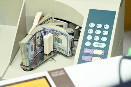 100 US dollar money in counting machine photo