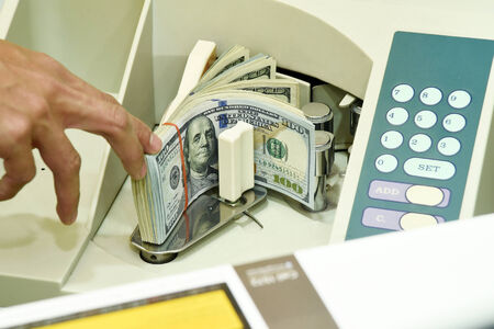 100 US dollar in money counting machine photo