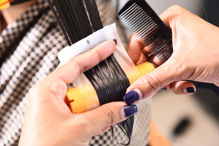 hair stylist: hair stylist curling hairs