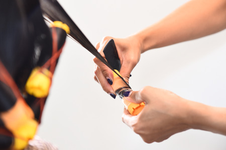 hot rollers: hair stylist curling hairs