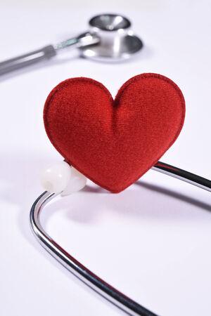 stethoscope isolated on white background: Red heart on stethoscope isolated white background.