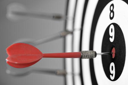 Dartboard with darts on gray background. photo