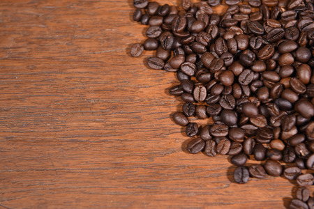 coffeetree: Coffee beans on wooden background.
