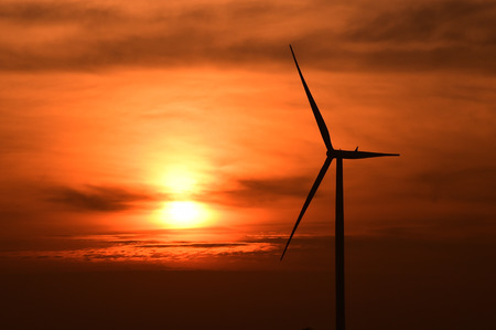 Wind turbines silhouette at sunset photo