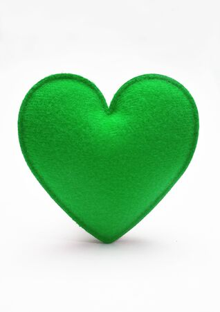 Green heart isolated on white background photo