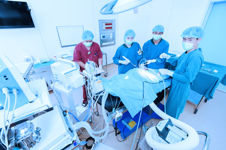 laparoscopic: group of veterinarian doctor in operation room for laparoscopic surgical take with blue filter Stock Photo