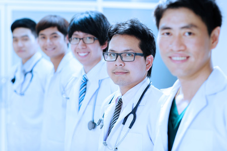 asian doctor: group of young asian doctor portrait take with blue filter Stock Photo