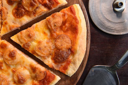woodenrn: close up of pizza on wooden background Stock Photo