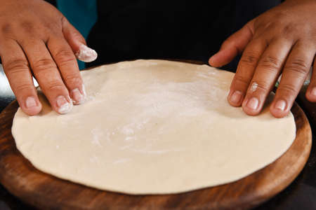 Chef Preparing pizza dough photo