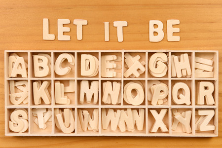 writing a letter: English alphabet set in wooden box