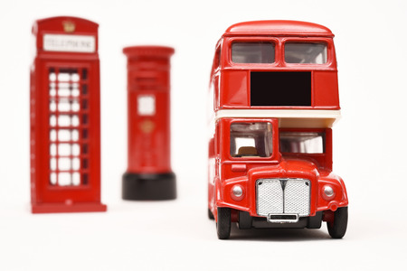 Postbox and red telephone box with red bus photo
