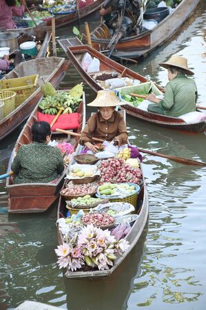 woodenrn: AMPHAWA ? APRIL 29: Wooden boats are loaded with fruits from the orchards at Tha kha floating market on April 29, 2015 in Amphawa. A traditional way still practiced in Tha kha canals of Thailand.