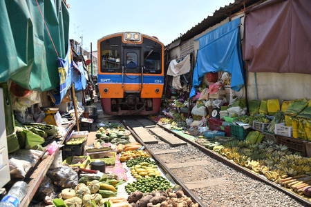 MAEKLONG  APRIL 29: The famous railway markets at Maeklong Thailand April 29 2015 Six times a day the train runs through these stalls.