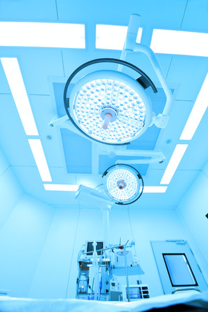 medical lighting: equipment and medical devices in modern operating room take with art lighting and blue filter Stock Photo