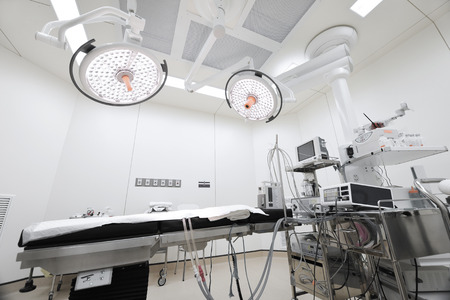 medical lighting: equipment and medical devices in modern operating room take with selective color technique and art lighting