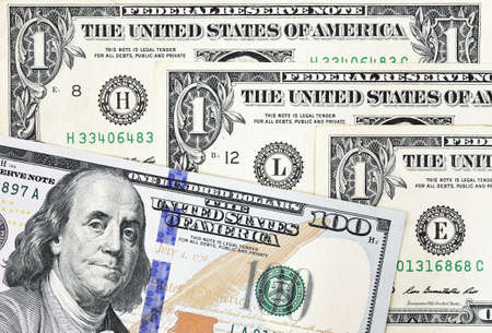 us paper currency: Macro shot of a new 100 dollar bill and one dollar on background Stock Photo