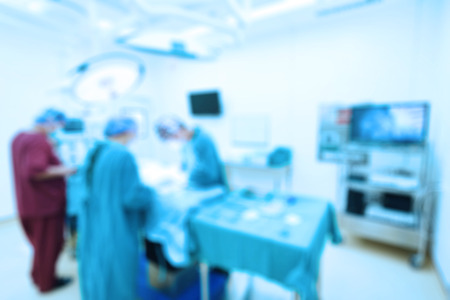 surgery doctor: Blur of group of veterinarian surgery in operation room take with art lighting and blue filter Stock Photo