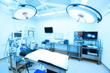 medical emergency service: equipment and medical devices in modern operating room take with art lighting and blue filter Stock Photo