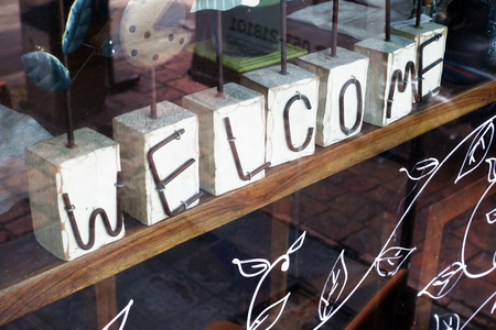 Welcome sign on wooden table