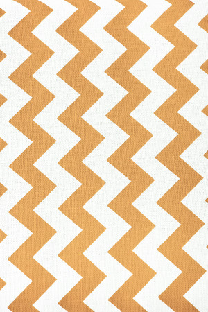 throw cushion: Pattern of yellow and white striped glides. Stock Photo