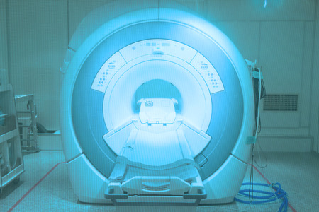 MRI scanner room in hospital take with art lighting and blue filter