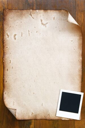 old photo: Old paper with photo frame on wooden background Stock Photo
