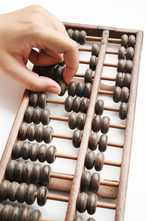 calculator chinese: Vintage abacus on white background