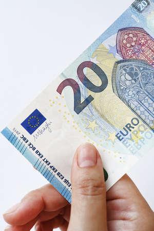 20 euro: 20 Euro on hand isolated on white background