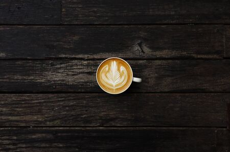 frothy: cup of latte art coffee on wooden background Stock Photo