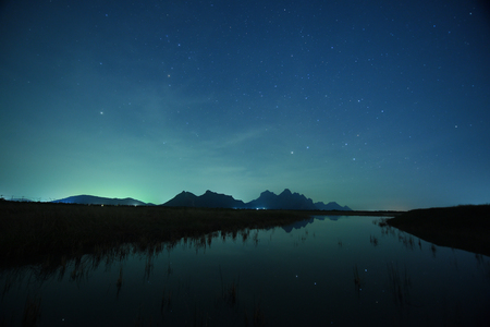 starry night: night sky stars with milky way on mountain background.