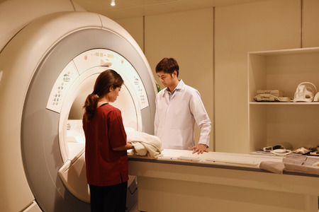 veterinarian doctor working in MRI scanner room at hospital