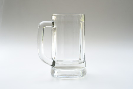 airtight: Empty glass for drinks on gray background Stock Photo