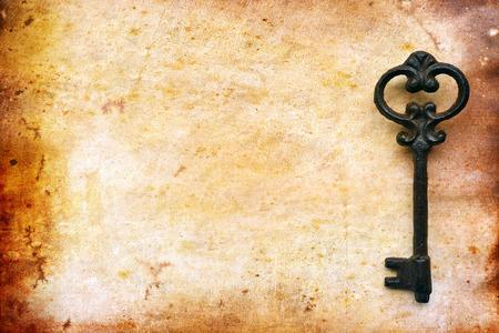 Vintage key on old paper for background