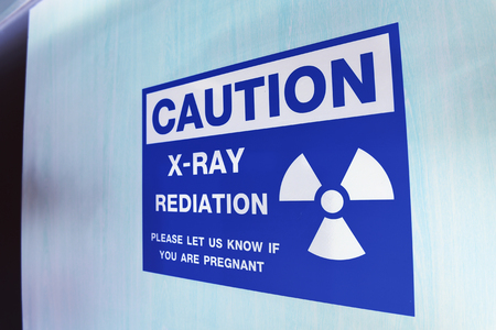Symbol of radioactivity and radiation from x-ray machine take with art lighting and blue filter