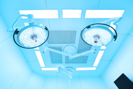 equipping: Two surgical lamps in operation room take with art lighting and blue filter