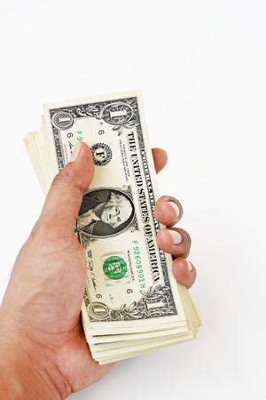 Billet de banque sur la main isolé sur fond blanc Banque d'images - 85941043