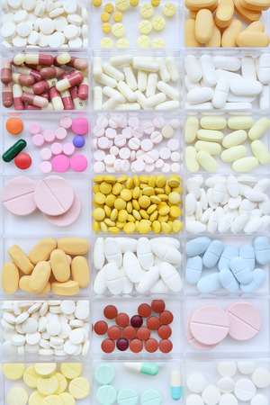 close up of different medication isolated on white background