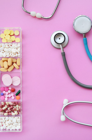 Different medication with stethoscope for background Banco de Imagens