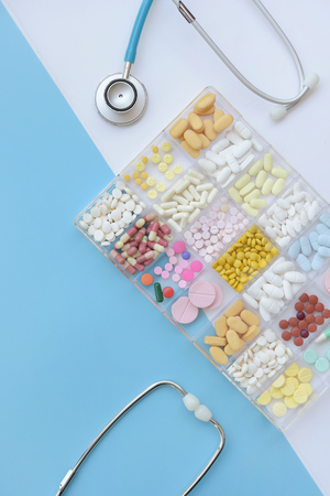 Different medication with stethoscope for background Stock Photo