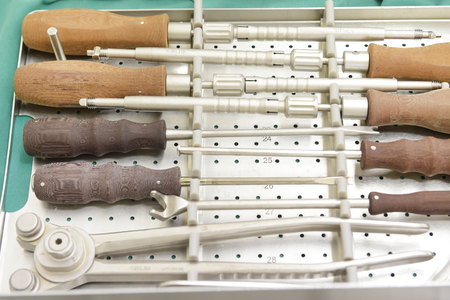 Detail shot of steralized surgery instruments with a hand grabbing a tool Stock fotó
