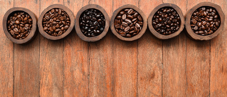 Close up of coffee beans in wooden bowl